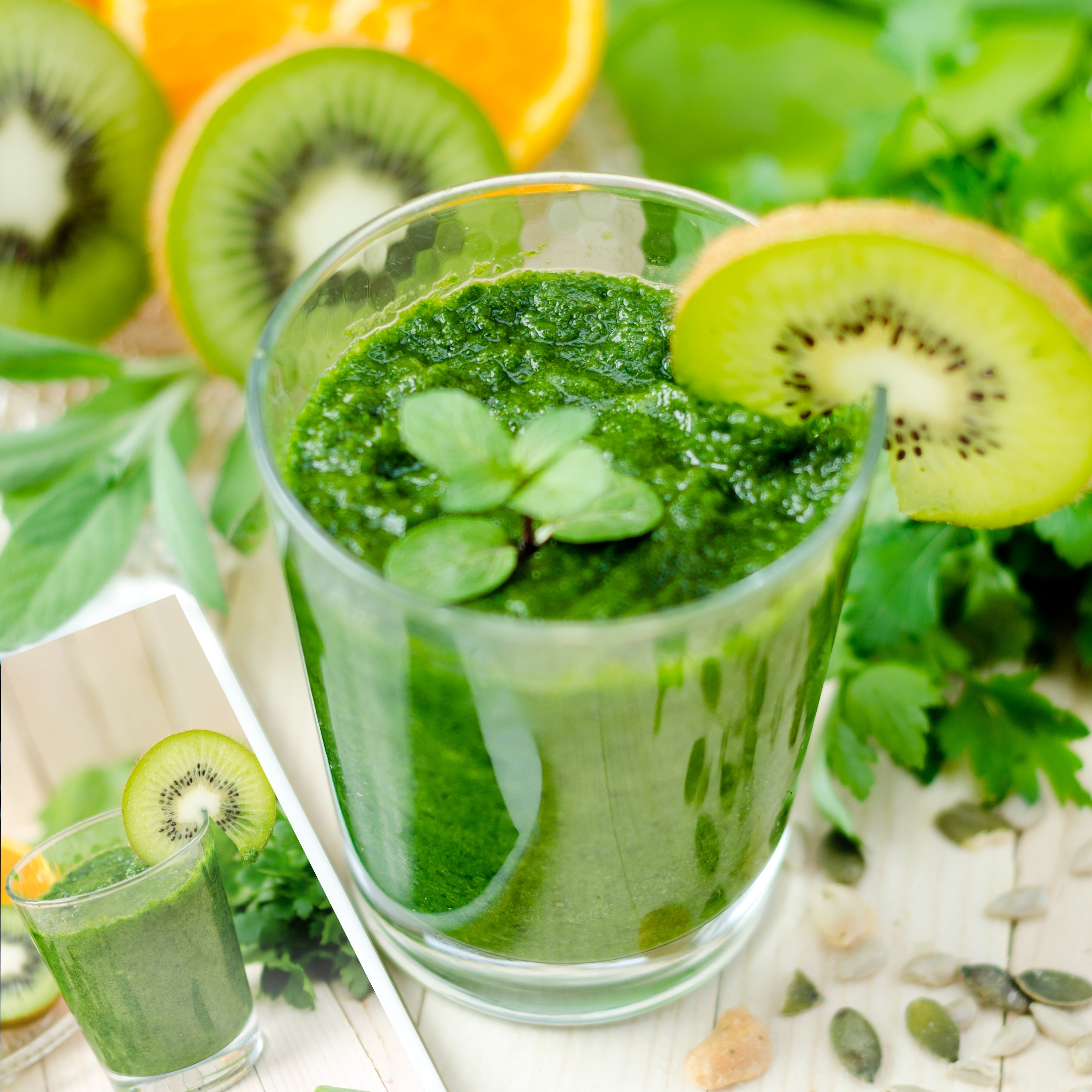 green smoothie in a glass with kiwi slices