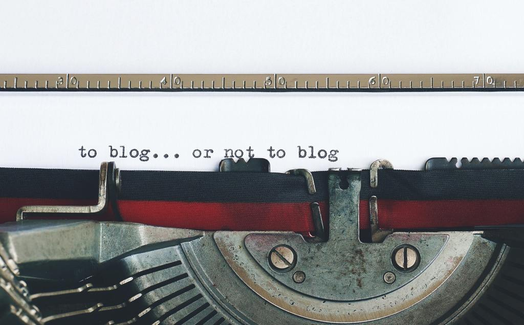 "vintage typewriter with ""to blog or not to blog"""